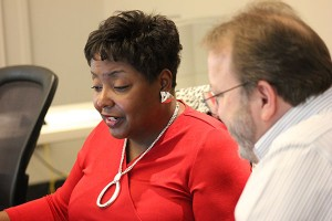 "Director of Academic Personnel Gwen Burston tests ConnectCarolina along with Mike Mathews, a School of Medicine personnel manager who is ""on loan"" to the project."